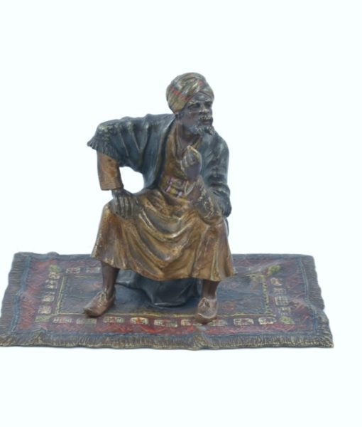 Bronze carpet seller 1